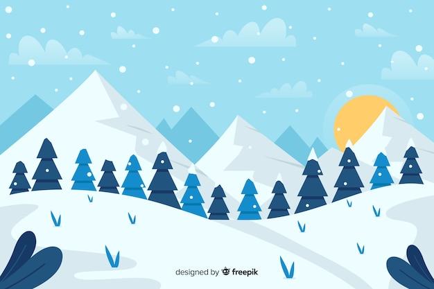 Bos van kerstbomen en bergen met zon