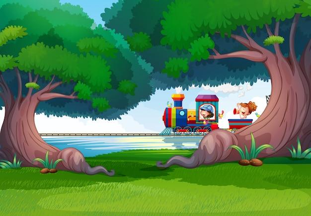 Bosscène met kinderen op de trein