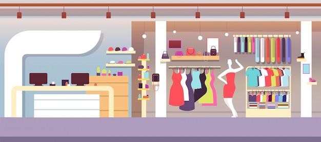 Boutique modewinkel met vrouwelijke kleding en damestassen.