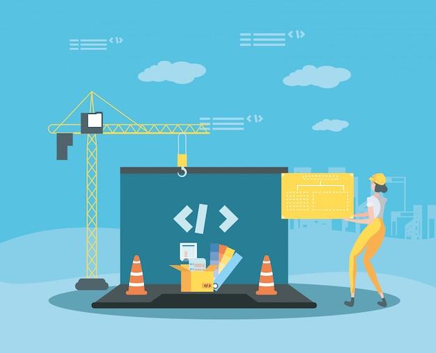 Bouwer en laptop met webpagina in aanbouw