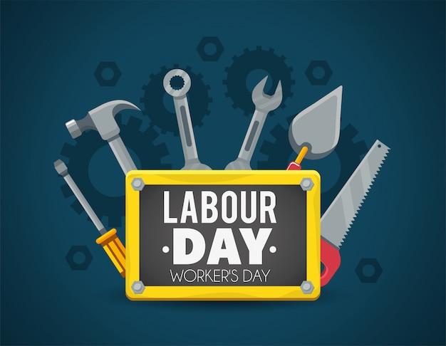 Bouwhulpmiddelen met embleem aan arbeidsdag