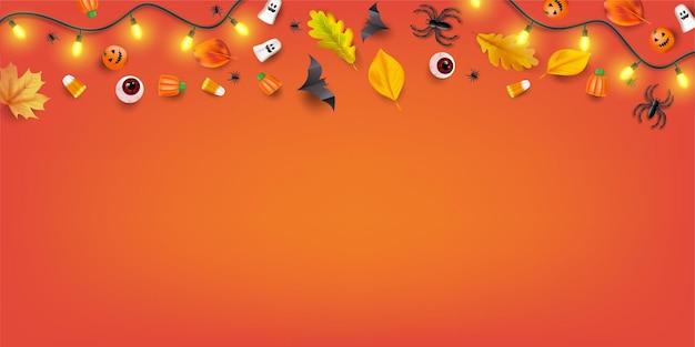 Bovenaanzicht halloween candy party achtergrond met snoep, oogbollen, spinnen, vleermuizen en pompoenen. vector