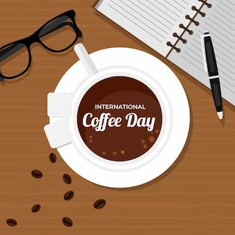 Bovenaanzicht kopje koffie en werkaccessoires