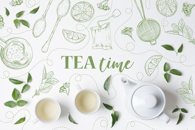 Bovenaanzicht kopjes thee met theepot