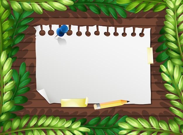 Bovenaanzicht van blanco papier op tafel met bladeren elementen