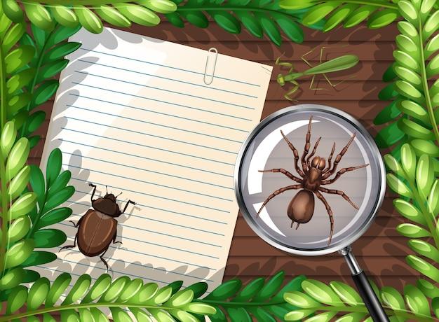 Bovenaanzicht van blanco papier op tafel met elementen van bladeren en insecten