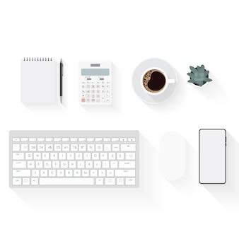 Bovenaanzicht van bureau werkruimte met koffiekopje, notebook, plastic plant, smartphone en toetsenbord