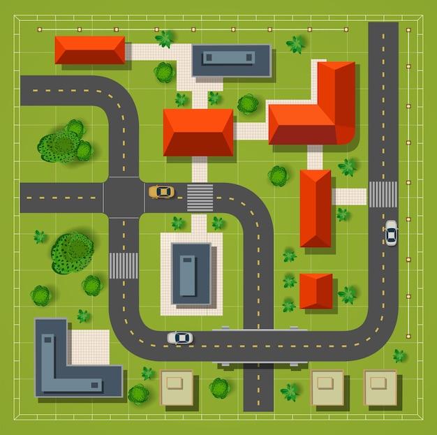 Bovenaanzicht van de stad met de stadswegen die auto's en bomen bouwen