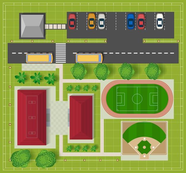 Bovenaanzicht van de stad vanaf de schoolgebouwen, een voetbalveld en honkbaldiamant