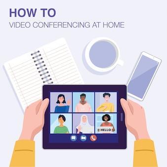 Bovenaanzicht van een man met videoconferentie op tablet met zijn vrienden thuis.