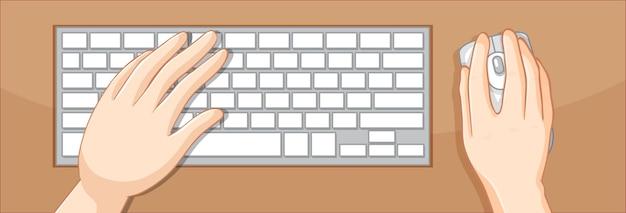 Bovenaanzicht van handen met toetsenbord en muis op tafel