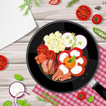 Bovenaanzicht van het ontbijt in de pan met voedselelement op tafel