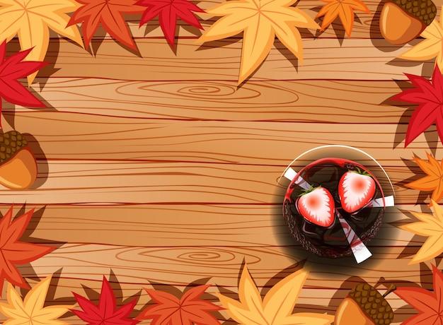 Bovenaanzicht van houten tafel met dessert en herfstbladeren element