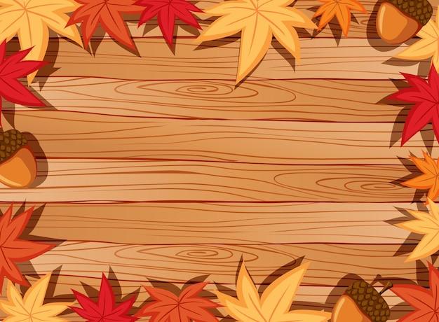 Bovenaanzicht van lege houten tafel met bladeren in herfst seizoen elementen