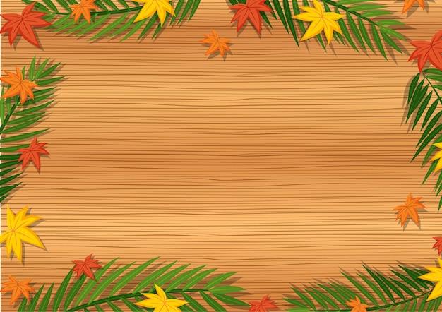 Bovenaanzicht van lege houten tafel met bladeren in verschillende seizoenelementen