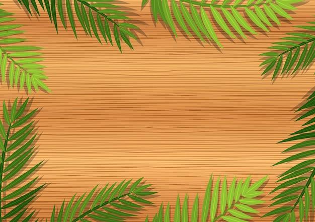 Bovenaanzicht van lege houten tafel met elementen van de bladeren