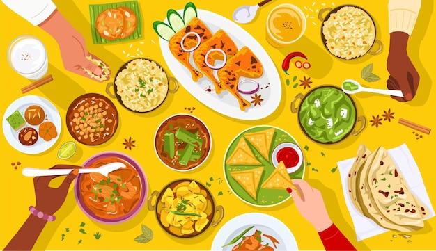 Bovenaanzicht van mensen die samen genieten van indiaas eten.