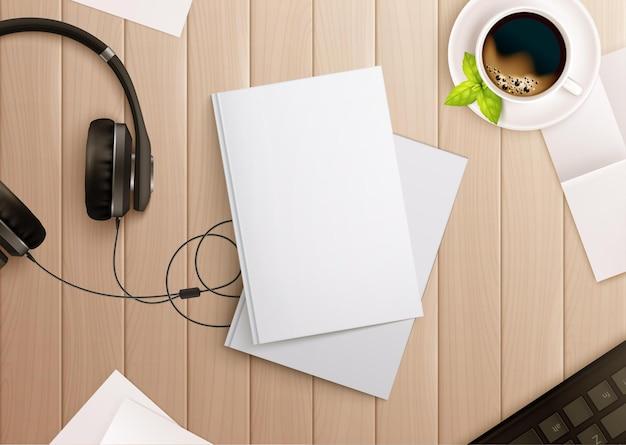 Bovenaanzicht van papier op tafel met koffie en koptelefoon