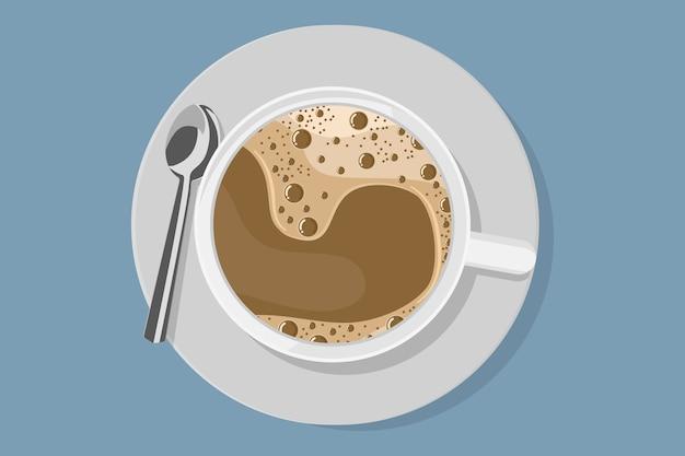 Bovenaanzicht van witte koffiekopje met plaat en lepel