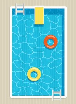 Bovenaanzicht van zwembad met opblaasbare cirkels.