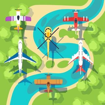 Bovenaanzicht vliegtuigen en helikopters boven landschap
