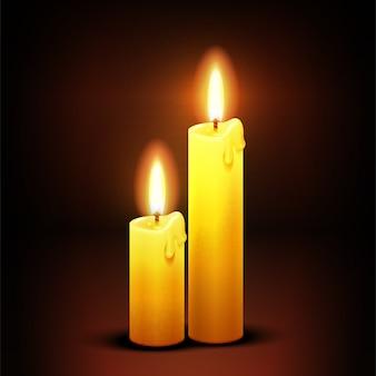 Brandende diner kaarsen op donker