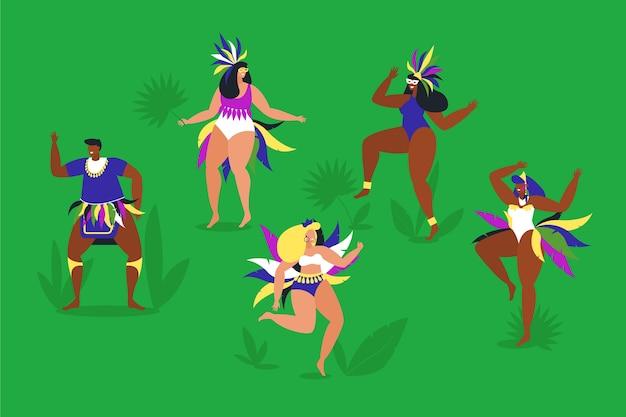 Braziliaanse carnaval-dansers die in het gras spelen