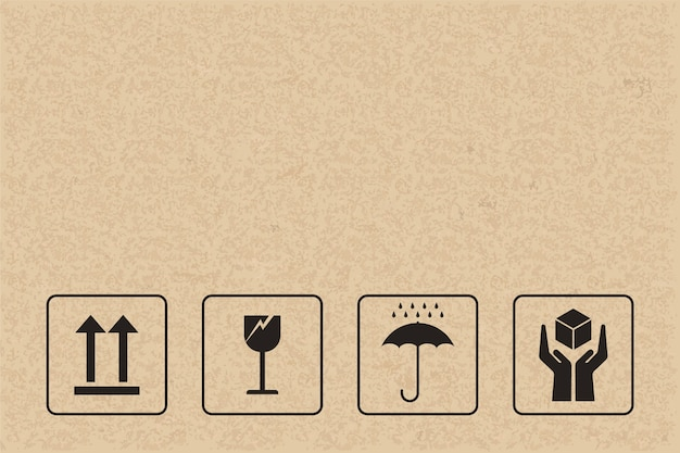 Breekbaar teken en symbool op bruin papier.