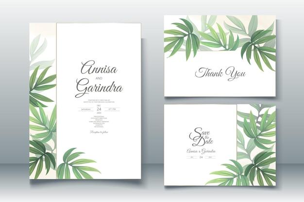Bruiloft uitnodigingskaart sjabloon set met prachtige tropische bladeren Premium Vector