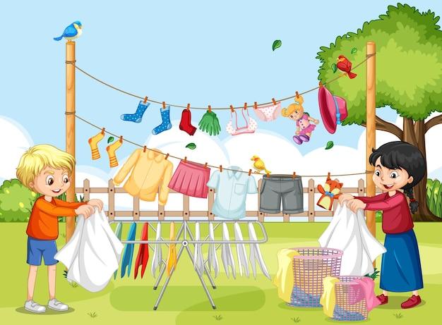 Buitenscène met kinderen die kleren aan waslijnen hangen