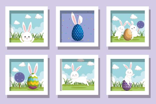 Bundel van pasen konijnen met versierde eieren