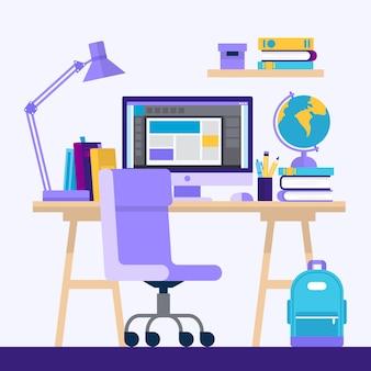 Bureau met computer en boeken.