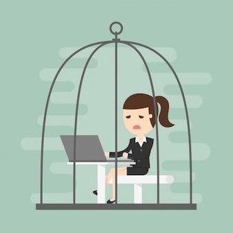 Business vrouw werkt in een kooi