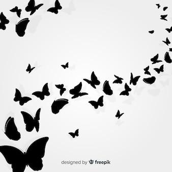 Butterfly zwerm silhouet achtergrond