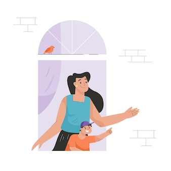 Buurvrouw in raamconcept vrouw met zoon kijkt uit appartement
