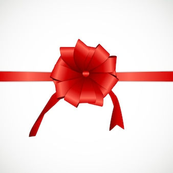Cadeaukaartenset met rood lint en strik.