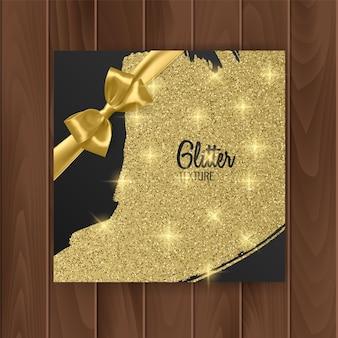 Cadeaukaartomslag met gouden glinsterende textuur en gouden strik.