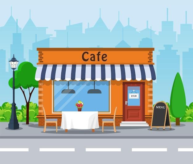Cafe winkel buitenkant. straat restaurant gebouw. stadsgezicht, gebouwen, wolken.