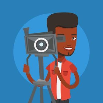 Cameraman met filmcamera op statief.