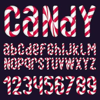 Candy cane glanzende vector alfabet. set letters en cijfers voor kerstversiering.