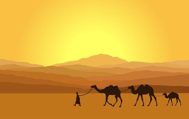 Caravan met kamelen in woestijn met bergen op achtergrond.