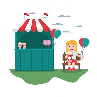 Carnaval winkel en meisje zitplaatsen met ballonnen