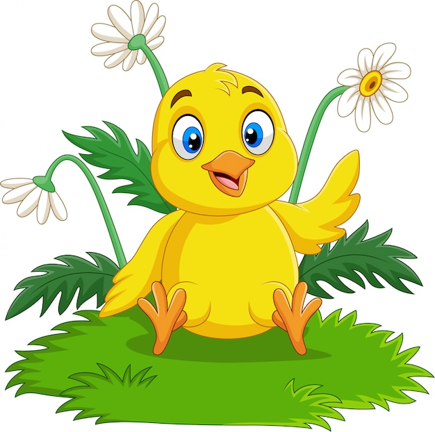 Cartoon baby chick zittend op het gras