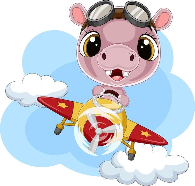 Cartoon baby-nijlpaard die een vliegtuig bestuurt