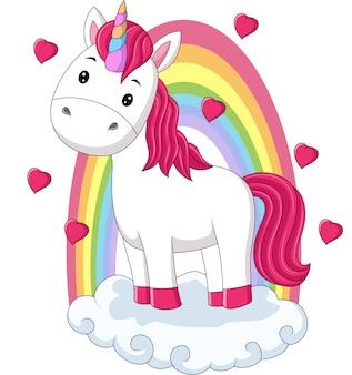 Cartoon baby pony eenhoorn staande op wolken met regenboog