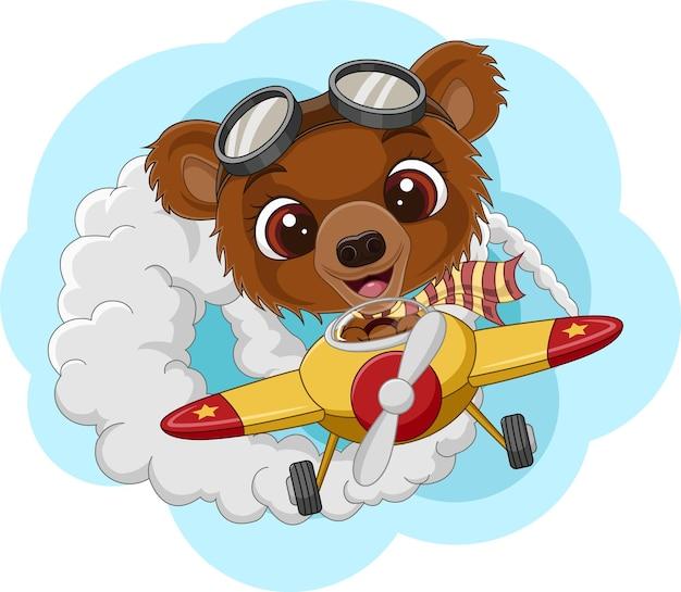 Cartoon babybeer die een vliegtuig bestuurt