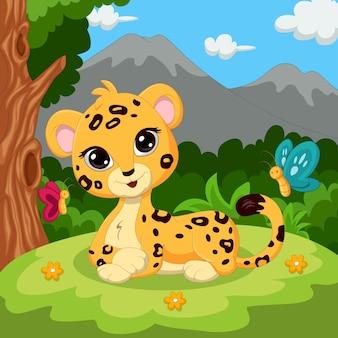 Cartoon babyluipaard zittend in het gras