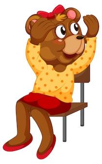Cartoon beer zittend op een stoel