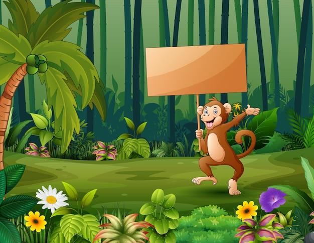 Cartoon een aap met houten bord in het bos