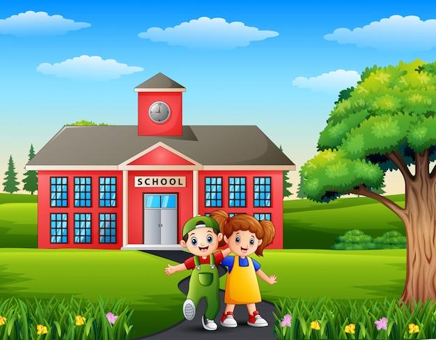 Cartoon een jongen en een meisje vooraan het schoolgebouw